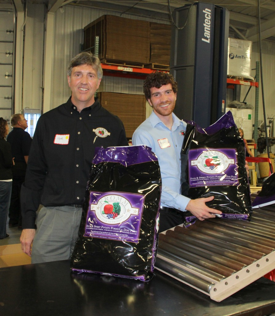 Bryan and his father, owner Tom Nieman holding the first bag produced during our ribbon cutting event at the new facility in Columbus.